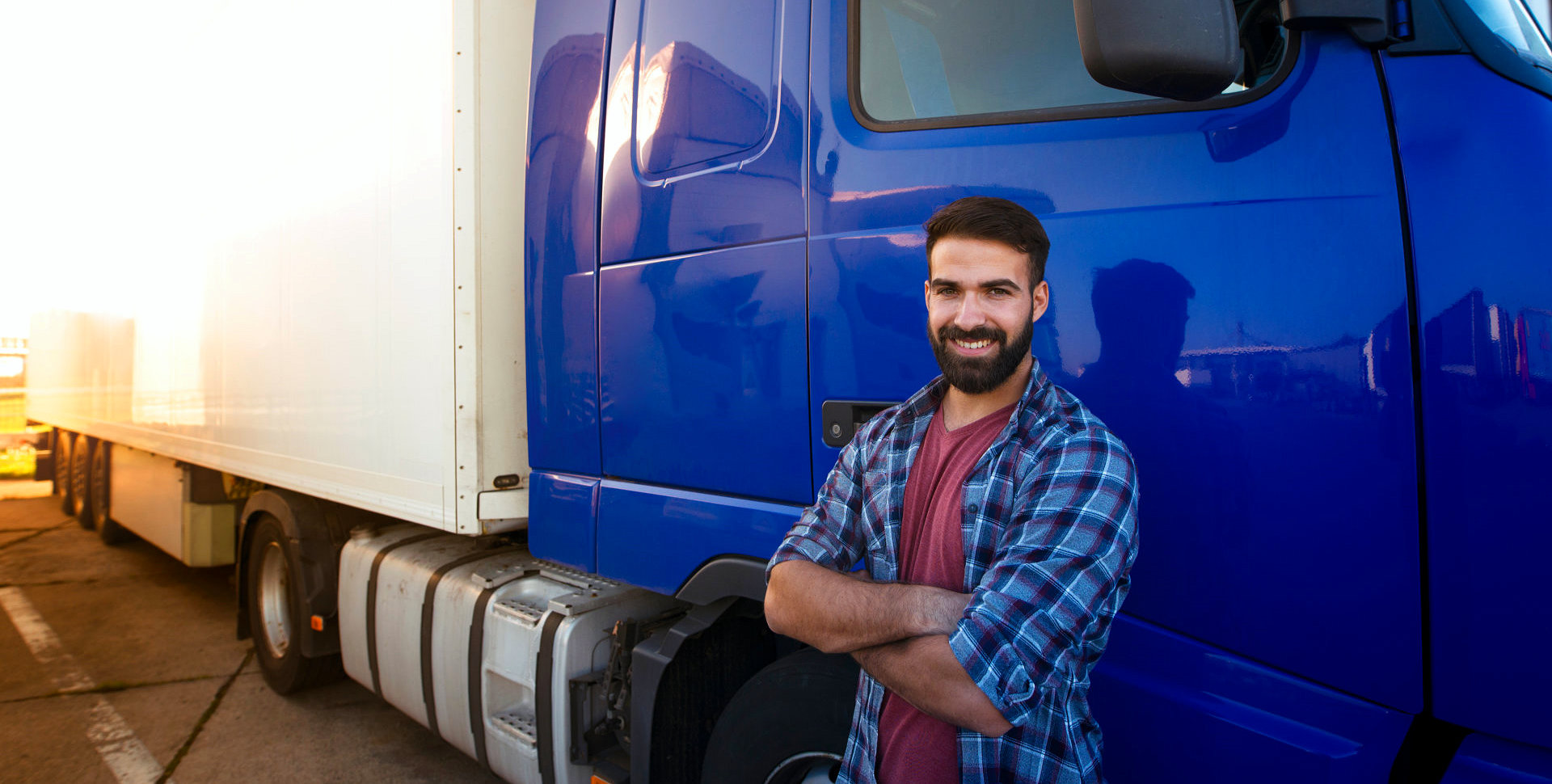 driver smilling with the blue truck