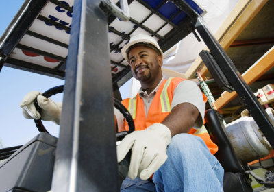 adult man driving a forklift concept